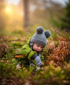 An under-five enjoying a Forest School