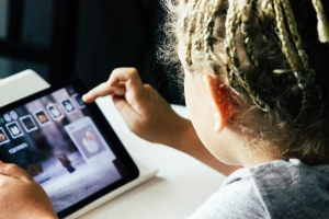 A preschooler using a tablet
