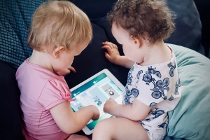 Toddlers as young as 3 are able to control many aspects of handheld devices