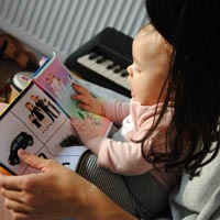 Reading with a baby or toddler is a great way to form a closer bond