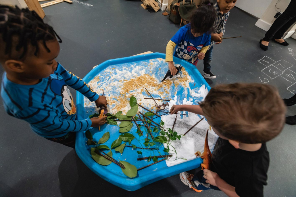 Children explore textures and natural resources through messy, sensory and creative play.