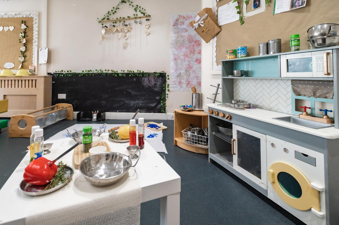 Children love our kitchen area where they can safely learn about cooking and preparing food.