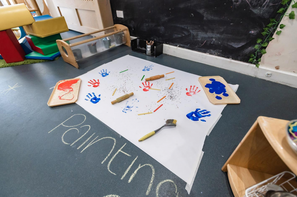 Painting and messy play activities at Leaps & Bounds Day Nursery.