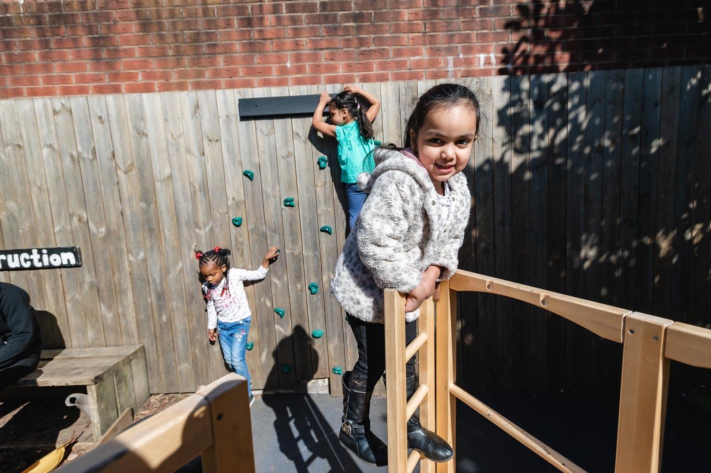 Children enjoying climbing activities.