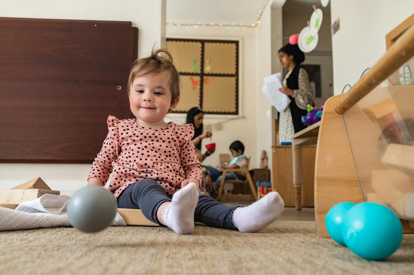 A child plays with a ball.